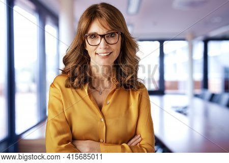 Confident Businesswoman Portrait While Standing In The Meeting Room