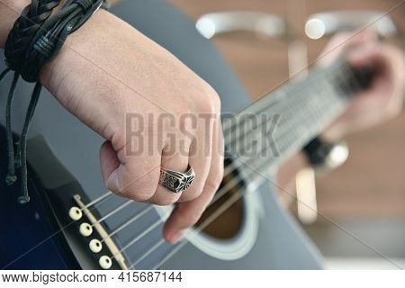 Guitarist Playing On Acoustic Guitar. Art And Music Concept. Close Up