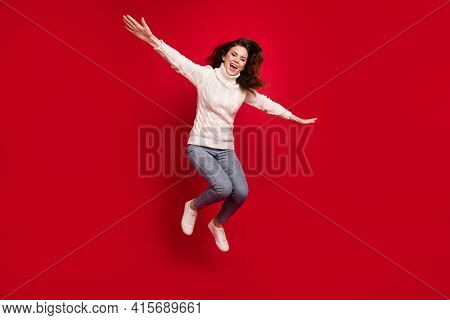 Full Length Photo Of Funny Cute Young Lady Wear Collar Pullover Arms Sides Jumping High Isolated Red