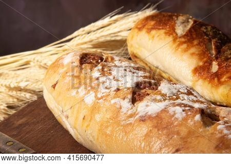 Breads, Beautiful Stuffed Breads Placed On Wooden Surface With Branch Of Wheat, Dark Abstract Backgr