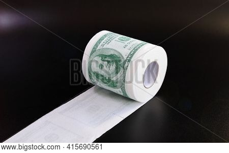 Roll Of Toilet Paper In Form Of Dollars, Concept Of Deficit And Inflation, On Black Background With