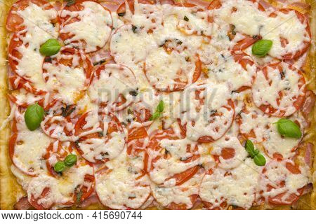 Appetizing Pizza With Ham And Cheese Tomatoes And Herbs Flat Lay Top View