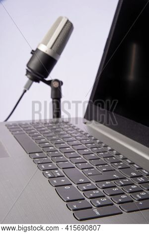 Home Work, Professional Condenser Microphone And Computer On Light Background, Selective Focus.