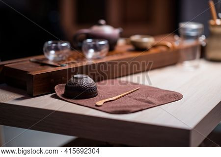 Clay Tea Cup And Bamboo Tea Needle For Picking Tea Cake On A Special Towel. Utensils For The Tea Cer