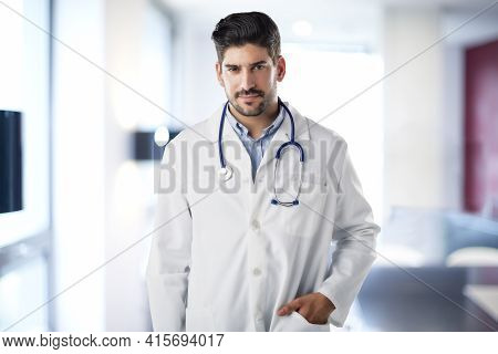 Male Doctor Portrait While Standing At The Hospital Foyer.
