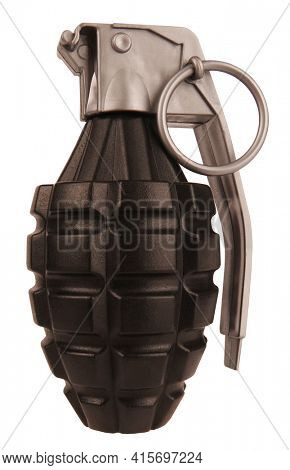 Hand grenade black and gray plastic toy isolated on white background