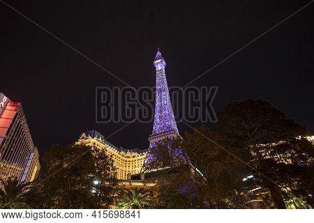 Las Vegas, Nevada, Usa - March 10, 2019: Paris Las Vegas Hotel And Casino At Night In Las Vegas, Nev