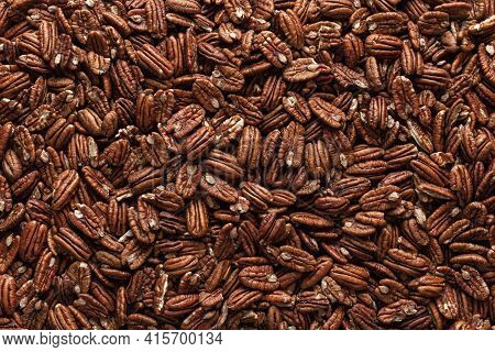 Pile Of Pecans, Full-frame Image, Directly Above View. Pecan Nuts Background. A Multitude Of Mexican