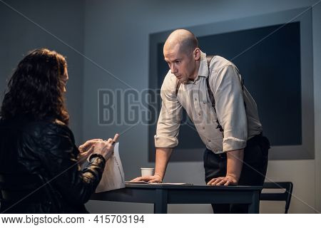 A Cheeky Guy Suspected Of A Crime Tears Up Documents During An Interrogation In Front Of An Investig