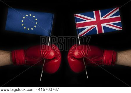 Two Boxing Gloves With European Union And Great Britain Flag. Great Britain And The European Union C