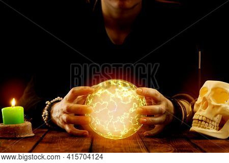 A Fortune-teller Or Oracle With Objects For Fortune-telling Holds A Fireball In His Hands To Predict