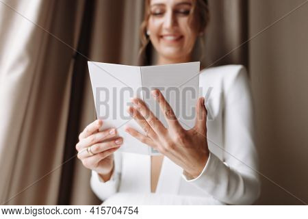 Wedding Day. Fees At The Hotel. The Bride Near The Window And Reads The Letter To The Groom. Wedding