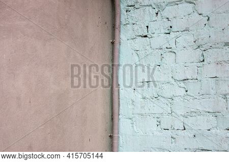 Concrete And Brick Wall Bisected Half On Half By A Corrugation