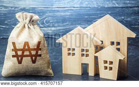 Bag With The Money And The Word Taxes And Wooden Houses. Taxes On Real Estate, Payment. Penalty, Arr