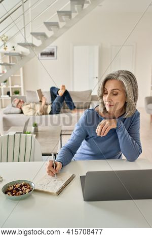 Senior Mature Woman Wife Remote Working Or Distance Learning Online From Home Office Using Laptop Co