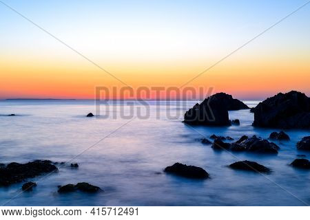 Beautiful Calm Sea And Sunset Scenery On The Ocean As Light Reflects On The Water