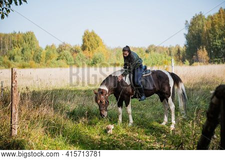 On A Sunny Day, The Girl Takes A Ride On Horseback Through The Expanses Of Her Estate
