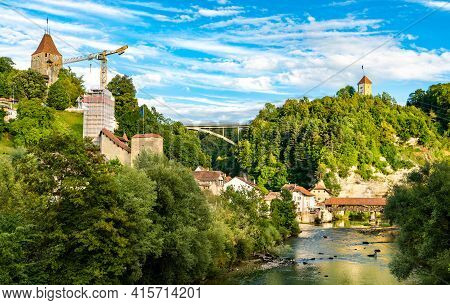 The Sarine River With Covered Bridge In Fribourg, Switzerland