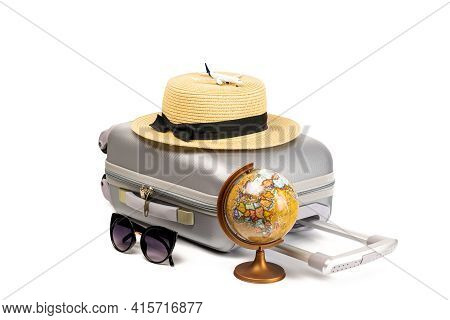 Suitcase Isolated On White. Suitcase, Sunglasses With Toy Plane, Straw Hat And Globe In Travel Compo