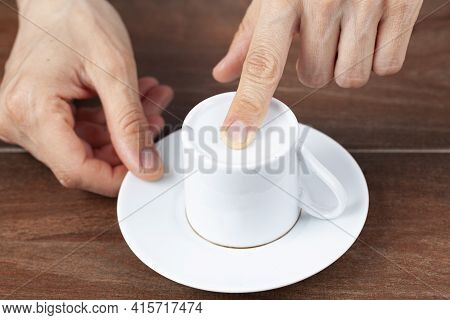 A Caucasian Woman Is Performing Fortune Reading ( Kahve Fali ) Using Leftover Coffee Grounds In Cera