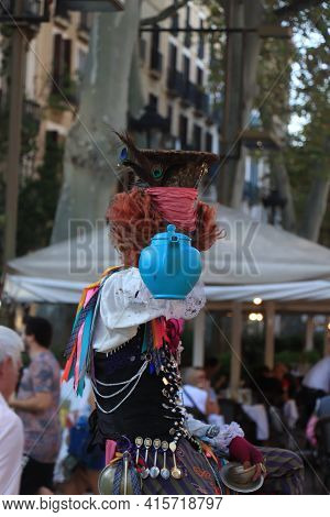 Barcelona, Spain - September 29th 2019: Colorful Street Artist, Performing The Mad Hatter From Alice