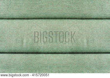 Seamless Texture Of Light Green Pillow Fabric With Seams. Textile Backdrops For Interior Designs