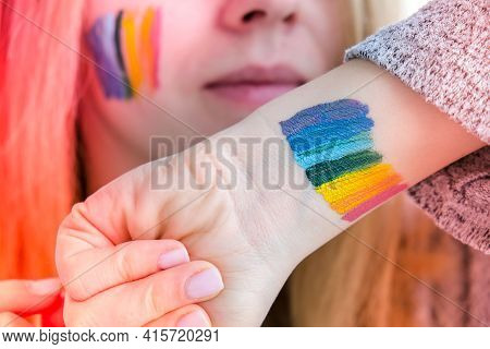 Rainbow Lgbtq Flag Painted On Hand And Cheek. Support For Lgbt Community. Honour Of Pride Month. Con