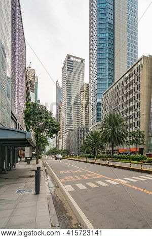 Makati, Metro Manila, Philippines - August 2018: Empty Avenue And Modern Financial Buildings Along A