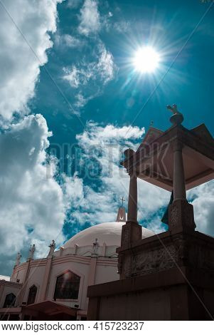 Church Under A Sunny And Cloudy Day. Catholic Devotees Flock This Structure For Prayers And Worships