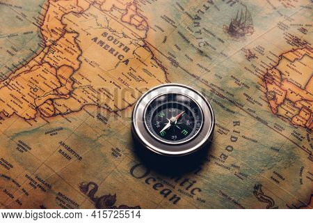 Old Compass Discovery On Vintage Paper Antique World Map Background, Retro Style Cartography Travel