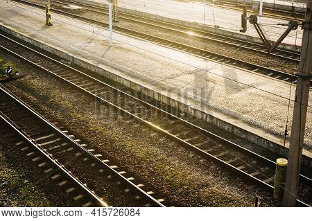 Sunset Over Train Station. Railway Top View Background. Train Transport Industry. Rail Track Texture