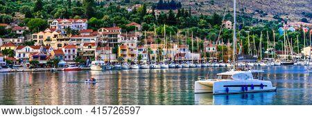 Greece travel. Catamaran sailing boats cruises. Kefalonia (Cephalonia) Ionian island, Agia Efiia village. june 2017