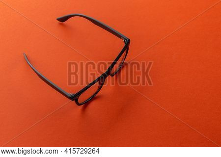 Eyeglasses On Orange Background, Myopia Or Presbyopia.  Eyesight Correction. Fashion Accessories.