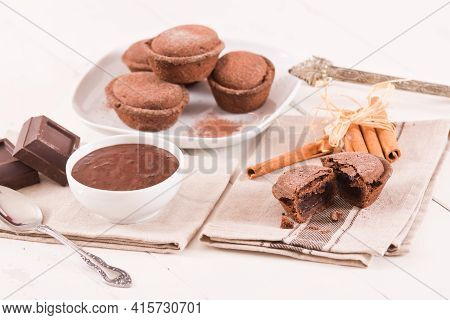 Pasticciotto Cake With Chocolate Filling On White Dish.