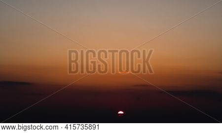 beautiful sunset sky time lapse, bright sun and dark silhouette of clouds as a background