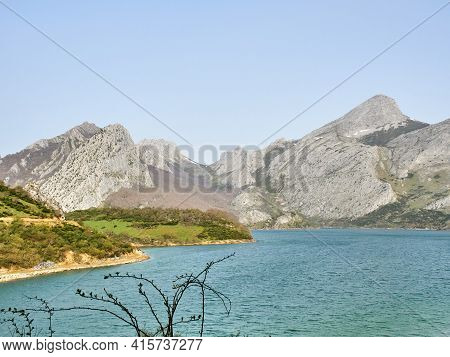 Horizontal View Of Mountains And Lake Among The Forest Trees. Mountains Of The Cantabrian Range And