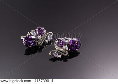 Bijouterie And Jewelry On A Dark Background. Rings, Bracelets And Pendants. Copy Space.
