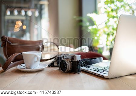 Digital Journalist's Desk With Technological Elements, Such As Camera And Laptop Computer.