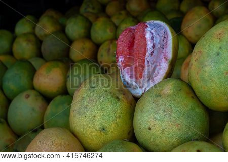 Fresh Ripe Fruits On Display In A Public Market. Close Up Shot With Narrow Depth Of Field.