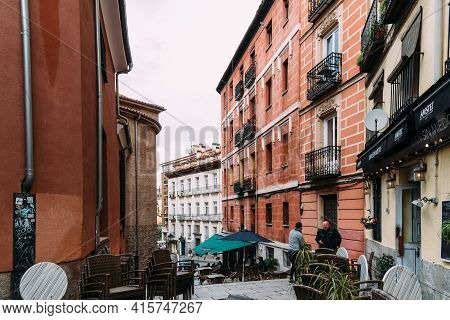 Madrid, Spain - April, 2, 2021: Cosy Narrow Street With Terraces Of Cafes And Restaurants In Central