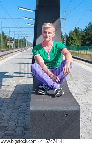 Handsome Blond Man Sitting On The Seat