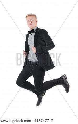 Young Caucasian Man Jumping In The Air
