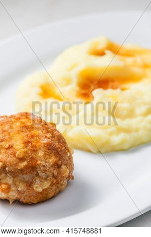 meat ball with cheese served with mashed potatoes