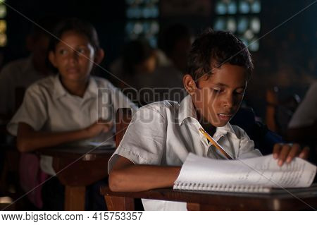 Bluff, Nicaragua. 03-17-2019. Portrait Of A Boy Studying And Doing His Homework At School In The Tow