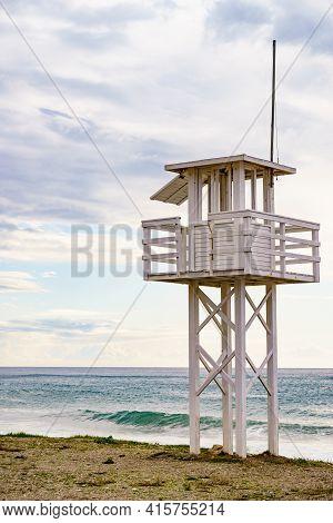 Coastal Landscape Sandy Seashore With Lifeguard Tower. Carchuna Beach. Costa Tropical, Granada. Anda