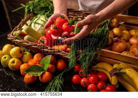 Assortment Of Fresh Vegetables And Fruits On Wooden Table