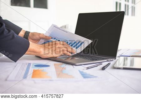 Hand Holding Paper Report  Business For Working In Office , Businessman Working And Check Report In