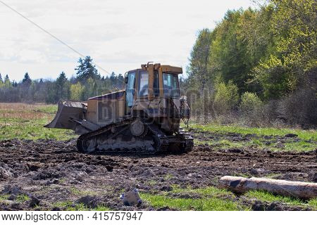 Bulldozer At Work. Planning Of The Area, Levelling Of The Site For Construction