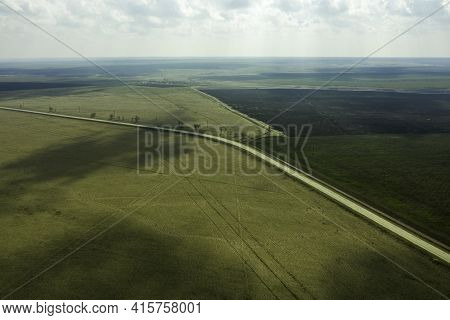 A Wedge Of Arable Land Among Fields And A Highway Spring Landscape Shooting From A Drone