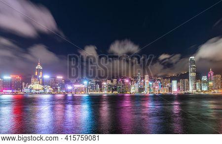 Hong Kong Downtown Skyline Across Victoria Harbor At Night, Hong Kong, China.
